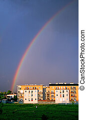 Rainbow on the sky - Rainbow after the storm over the modern...
