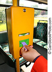 Validating a bus ticket - Woman is validating the ticket in...