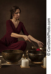 Woman with Tibetan singing bowls - Woman with Tibetan...