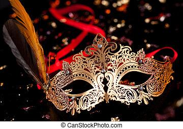 Carnival mask. - Golden carnival mask on black background.