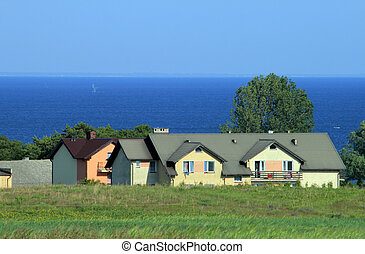 Houses at the coastline - Houses on the shore of the sea