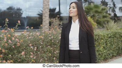 Charismatic stylish young businesswoman standing on the...