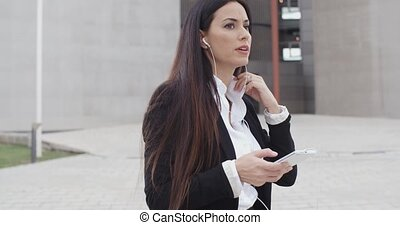 Young woman listening to a mobile call - Young businesswoman...