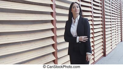 Stylish businesswoman in a hurry