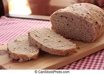 Sliced wholemeal bread with seeds - Organic wholemeal bread...