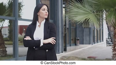 Impatient smart young businesswoman waiting for someone to...