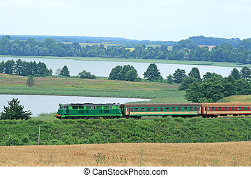 Passenger train passing through the lakeside