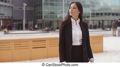 Stylish businesswoman waiting for someone standing in an...