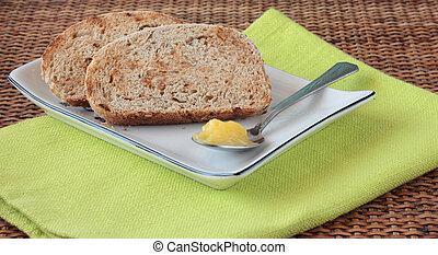 Sliced wholemeal bread with seeds and ghee clarified butter...