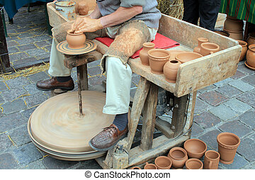 Loam pottery - Man making a loam pottery at a market