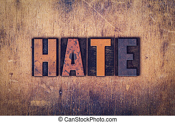 Hate Concept Wooden Letterpress Type - The word Hate written...