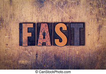 Fast Concept Wooden Letterpress Type - The word Fast written...