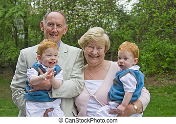 Grandparents with grandsons - Grandparents holding twin...