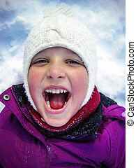 Mad joy - Little girl laying in snow with open mouth