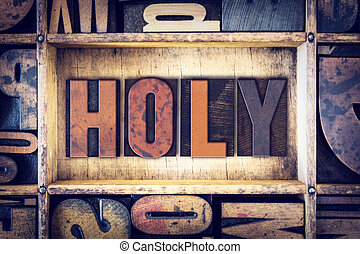 Holy Concept Letterpress Type - The word Holy written in...