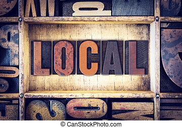 Local Concept Letterpress Type - The word Local written in...