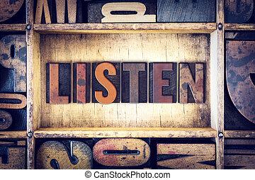 Listen Concept Letterpress Type - The word Listen written in...