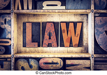 Law Concept Letterpress Type - The word Law written in...