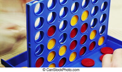 Connect Four board game - Children play board game Connect...