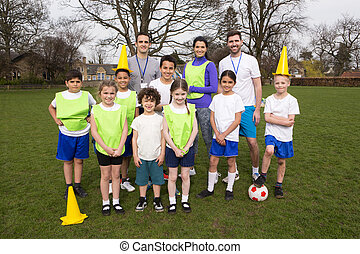 Kids Soccer Team - A group portrait of a kids soccer team,...
