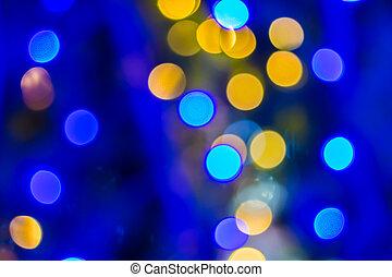 Defocused ligths of blue Christmas tree background