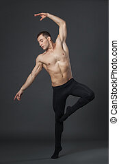 Modern ballet dancer in studio.