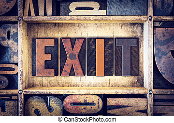 Exit Concept Letterpress Type - The word Exit written in...