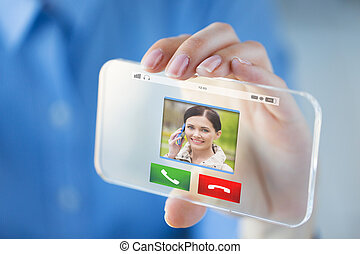 close up of hand with incoming call on smartphone -...