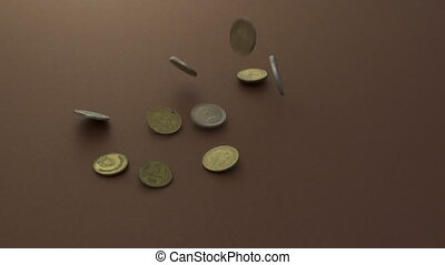 Coins falling onto a group of other coins - Coins falling in...
