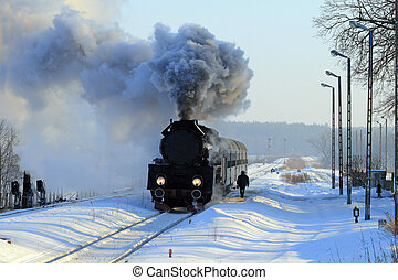Old retro steam train - Vintage steam train stopped at the...