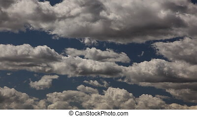 Time-lapse Clouds Over Deep Blue Sky - 1080
