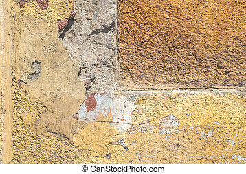 chipped plaster on concrete wall - fragment of a concrete...