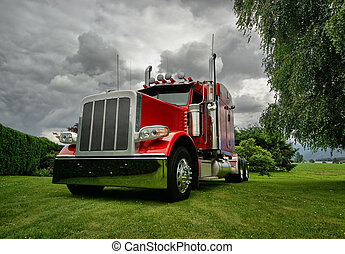 Semi Tractor Truck - A red semi tractor truck on a green...