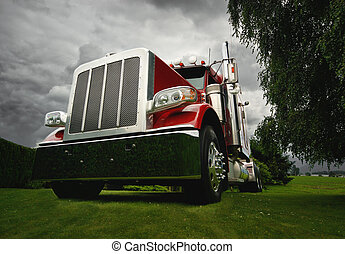 Modern Semi Tractor - A red semi tractor truck on a green...