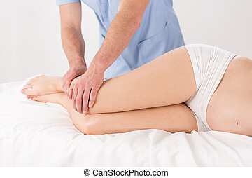 Woman's legs massage - Physical therapist doing pregnant...