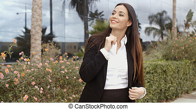 Attractive stylish woman waiting for a friend looking...