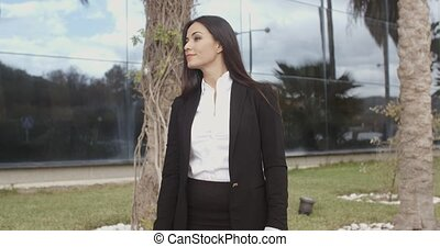 Young professional woman standing waiting for someone...