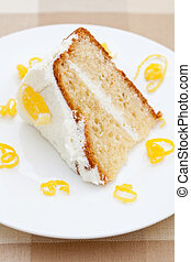 Slice of delicious lemon sponge cake with lemon rind on a...