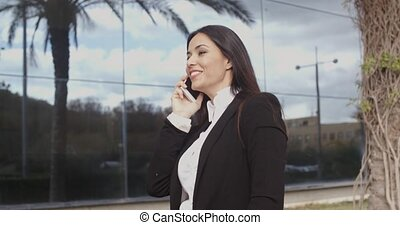 Confident businesswoman talking on her mobile