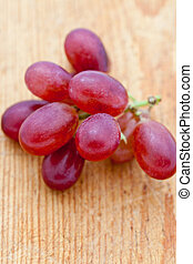 Bunch of fresh seedless red grapes