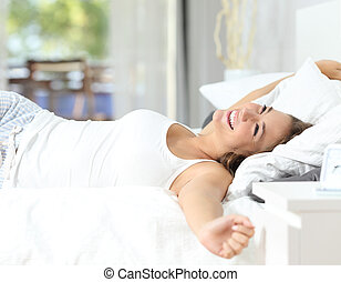 Girl waking up stretching arms on the bed - Happy girl...