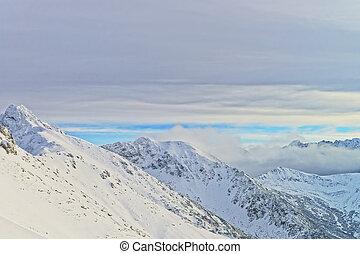 Clouds over Kasprowy Wierch of Zakopane in Tatra Mounts in...