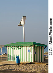 Beach hut on a sunny Mediterranean beach resort
