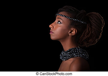 Young beautiful african woman wearing traditional jewelry,...