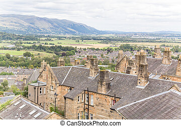 Cityscape of Stirling with country plains in the back seen...