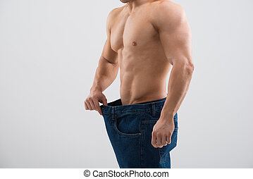 Muscular Man In Old Jeans Showing Weight Loss - Midsection...