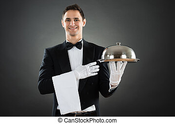 Portrait Of Happy Waiter With Tray And Towel
