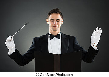 Smiling Music Conductor Holding Baton