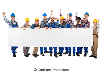 Happy Carpenters With Arms Raised Holding Blank Billboard -...