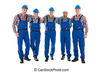 Confident Male Carpenters Standing With Arms Around - Full...
